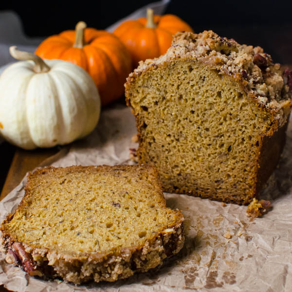 Banana Pumpkin Streusel Quick Bread sliced with pumpkins