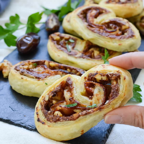 holding Prosciutto and Date Palmiers