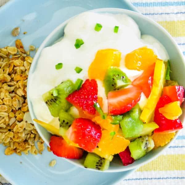 Tropical Fruit Salad over yogurt with granola.