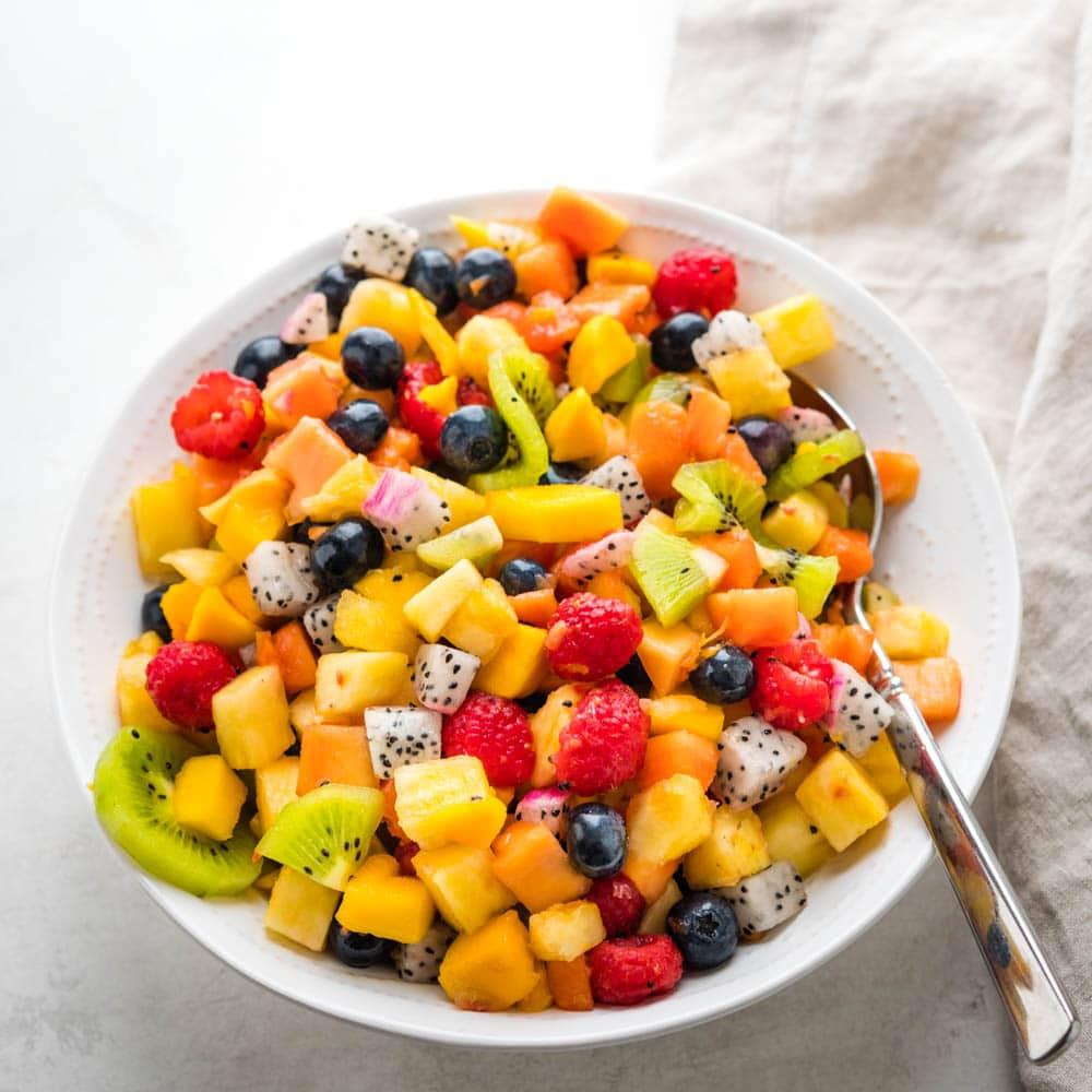 a bowl of fresh tropical fruit salad.
