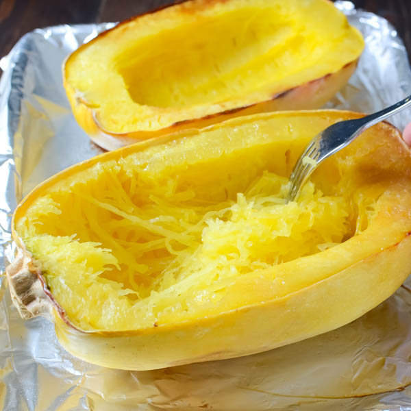 Loosen the strands from spaghetti squash with a fork.