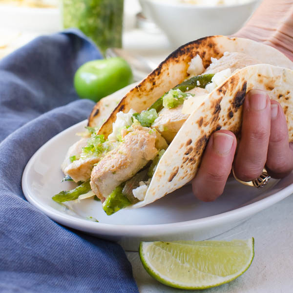 Chicken Soft Tacos with Fresh Tomatillo Salsa in hand