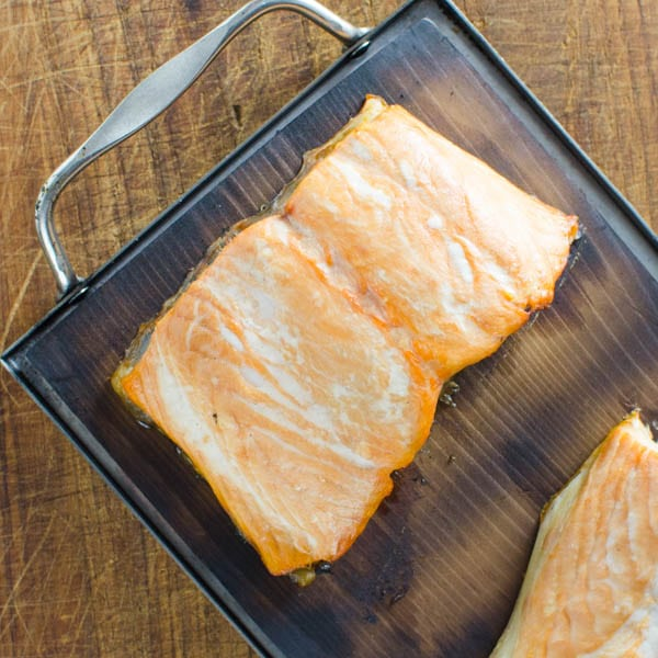salmon smoked on wood plank.