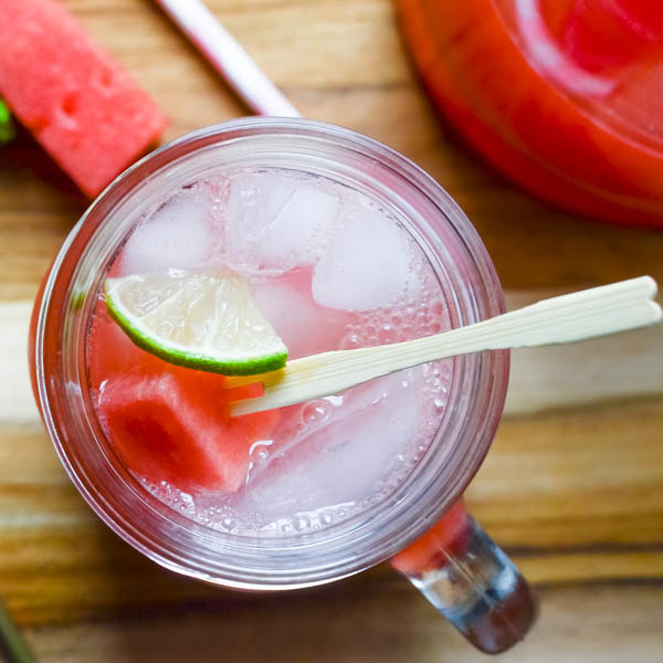 a glass with Watermelon-Mint Agua Fresca.