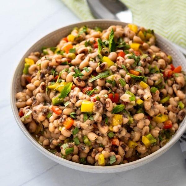 A serving bowl of bean salad.