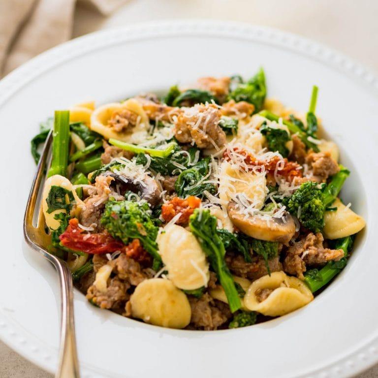 a dish of orecchiette sausage and broccoli rabe.
