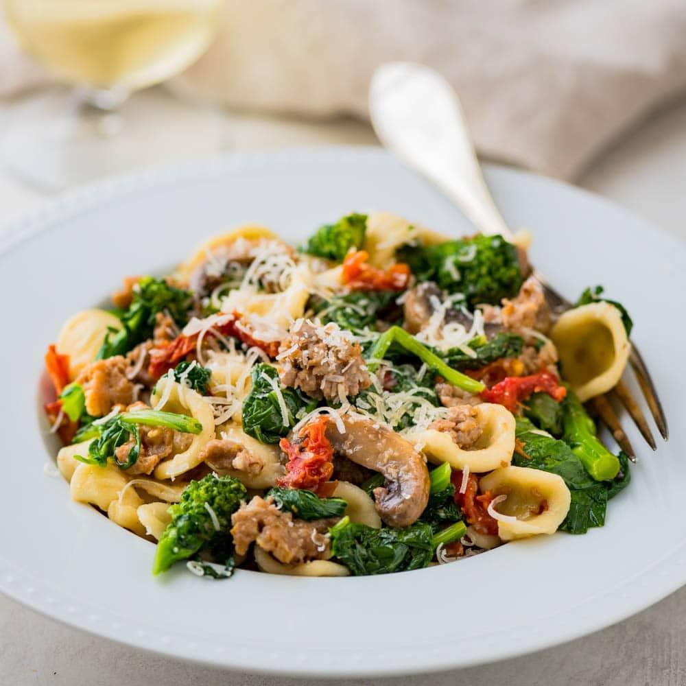 A serving of orecchiette, sausage and broccoli rabe.