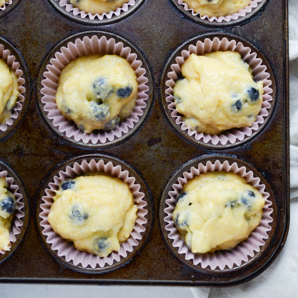 muffin tin with batter in the cups.