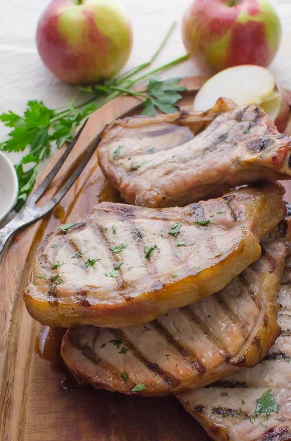 Brined Grilled Pork Chops on cutting board.