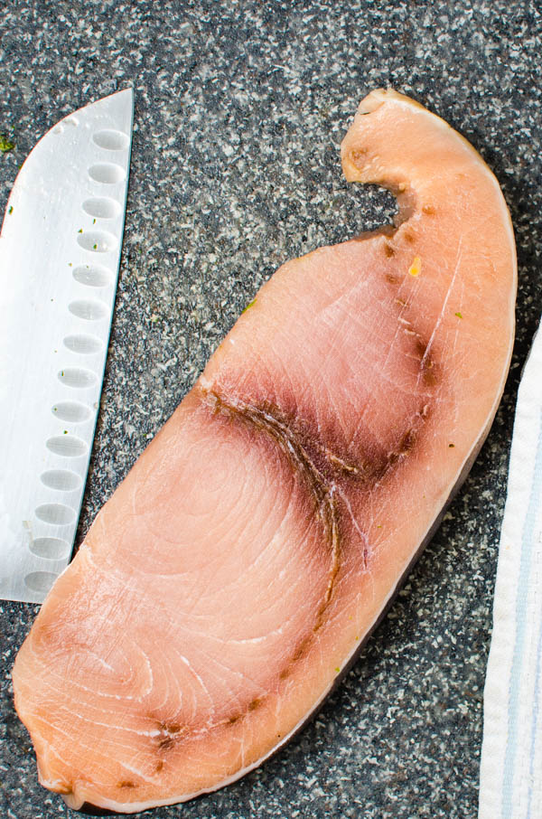 a swordfish filet on a cutting board.