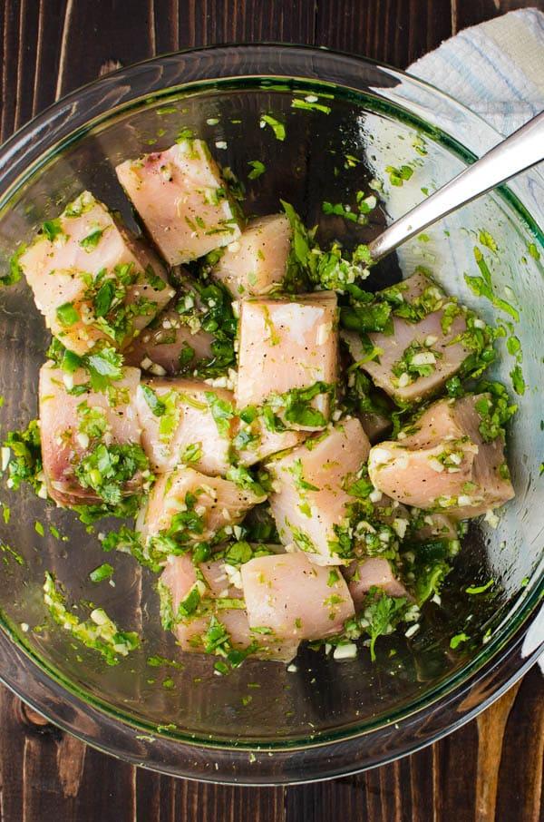 tossing fish in swordfish marinade.