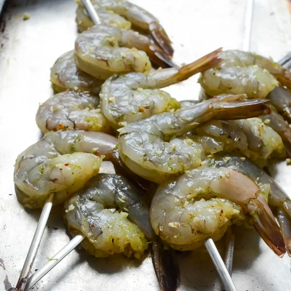 raw shrimp on skewers.
