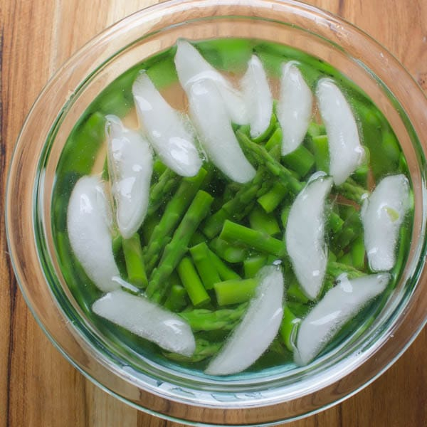 shocking asparagus in ice water.