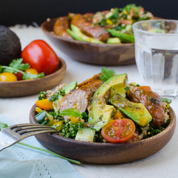 Spicy Sausage, Tomato and Avocado Salad with water glass