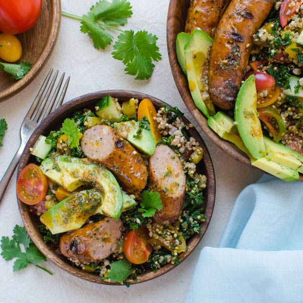 serving Spicy Sausage, Tomato and Avocado Salad with fork