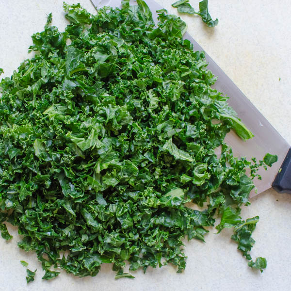 chopped kale on a board.
