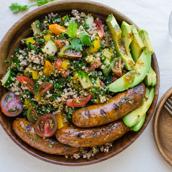 Spicy Sausage, Tomato and Avocado Salad in a bowl.