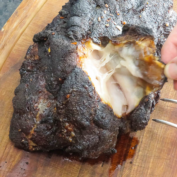 pulling back bark and fat cap from pork shoulder