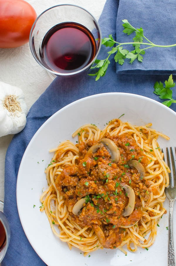 Sausage and Mushroom Ragout on a plate with wine