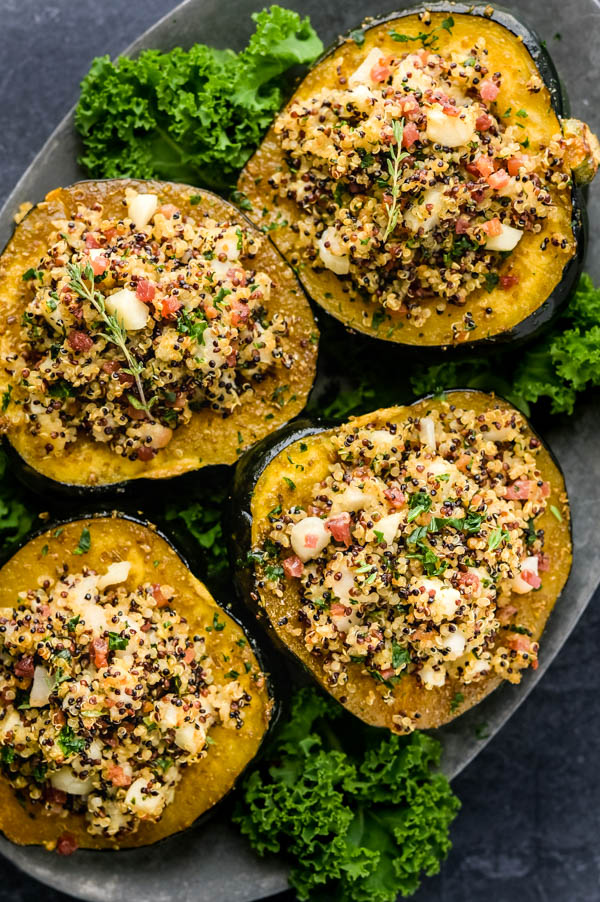 Quinoa stuffed healthy acorn squash recipes on a platter.