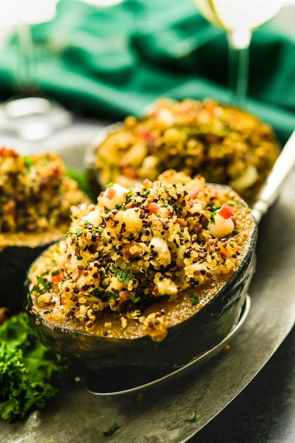 Serving quinoa stuffed acorn squash.