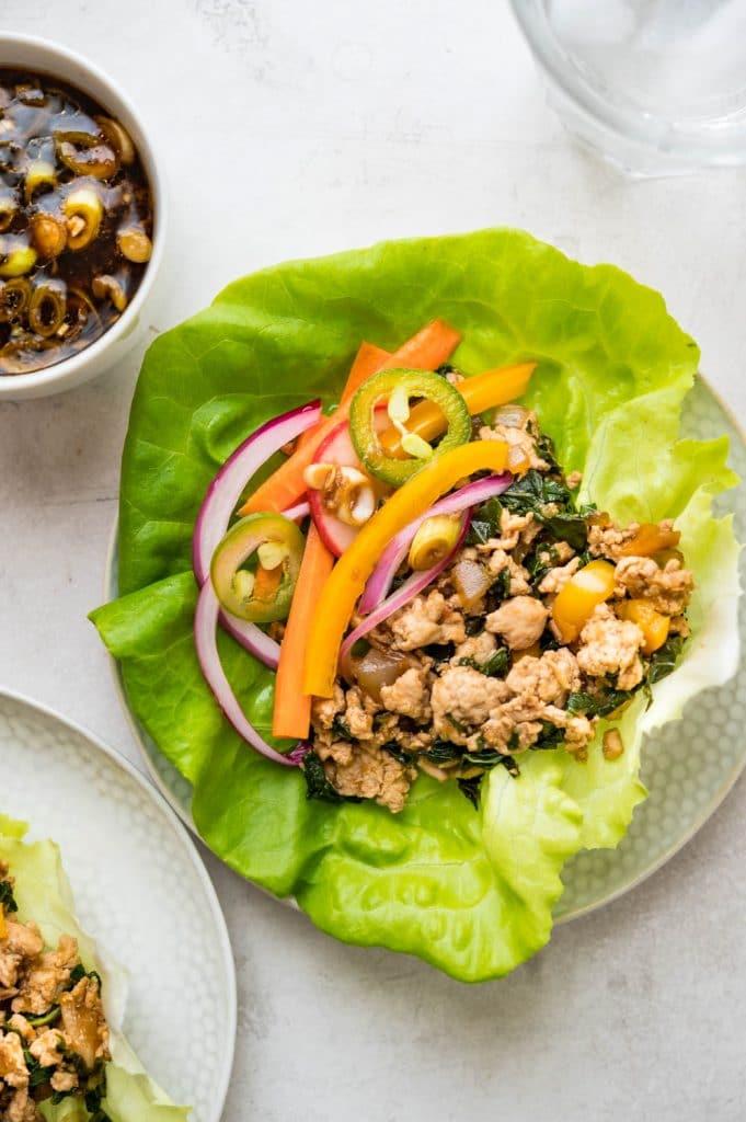 Amazing Asian Turkey Lettuce Wraps in a leaf of Boston lettuce.