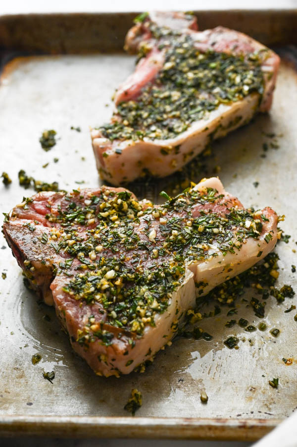 Best grilled veal recipes starts with coating the meat in garlic herb rub before grilling.