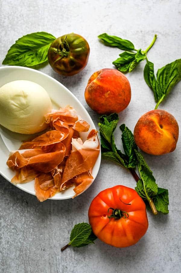 tomatoes, basil, peaches, ham and mozzarella cheese.