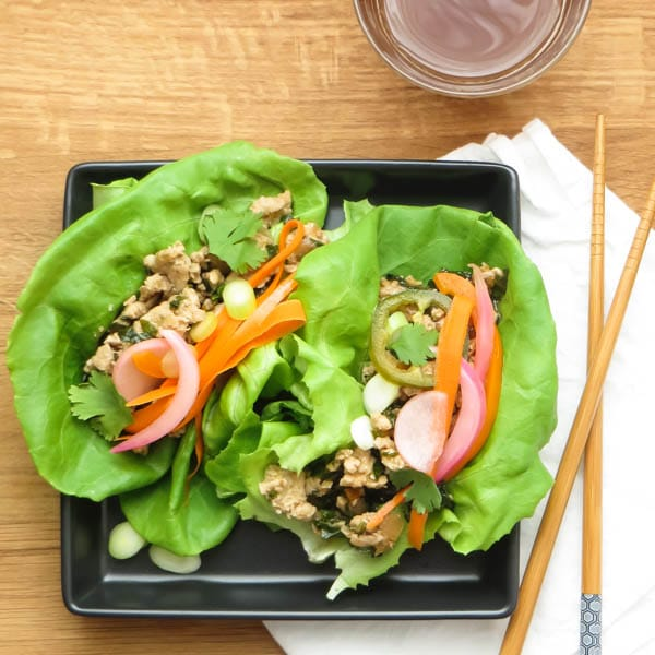 Asian Turkey Lettuce Wraps with Quick Pickled Veggies and chopsticks.