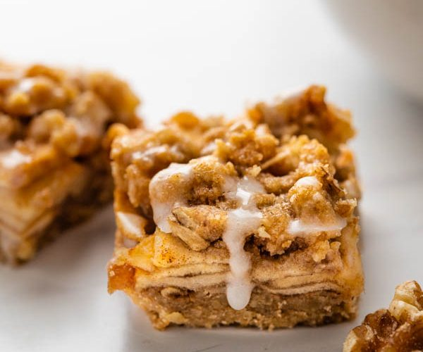 apple bars with oatmeal streusel and glaze. dripping down.
