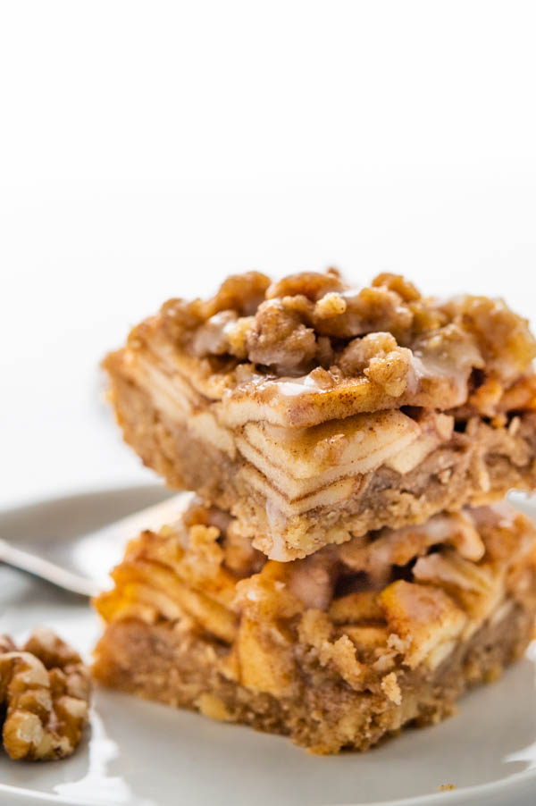 a stack of apple crumble barswith cinnamon walnut oatmeal streusel topping.