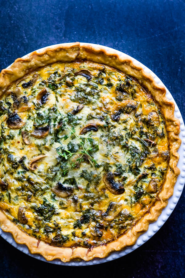 overhead view of kale and mushroom quiche.