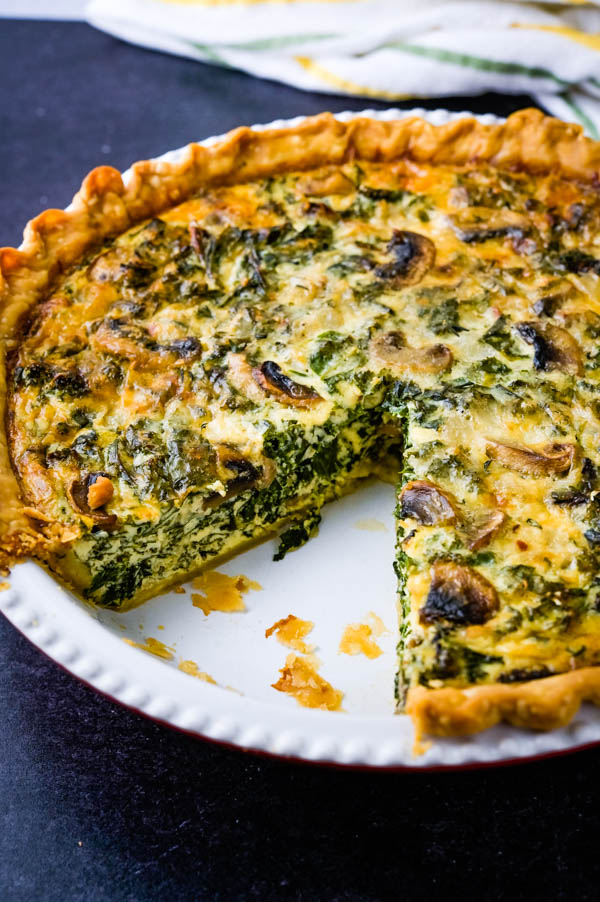quiche dish with a slice removed.