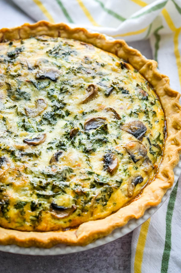 baked kale quiche hot from the oven. This vegetarian quiche is hard to resist.