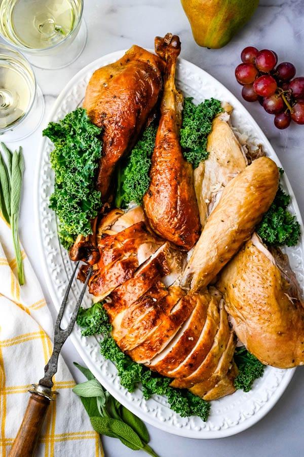 serving brined roast turkey on a platter.