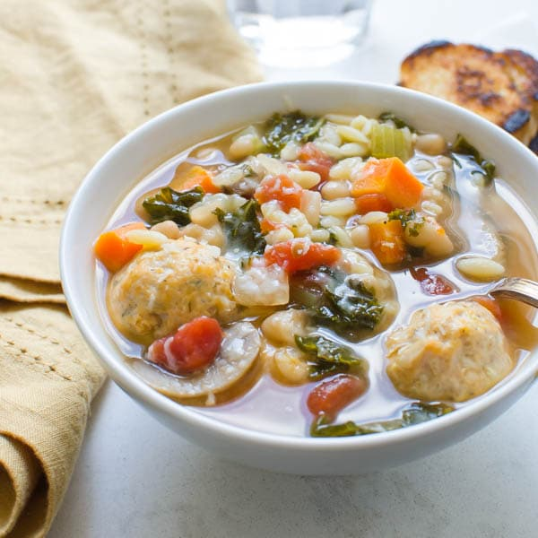 Kale, White Bean and Meatball Soup with spoon