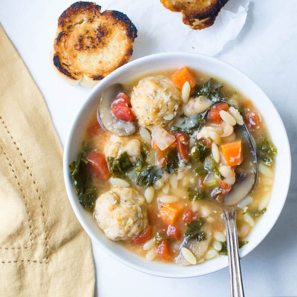 Kale, White Bean and Meatball Soup with charred bread