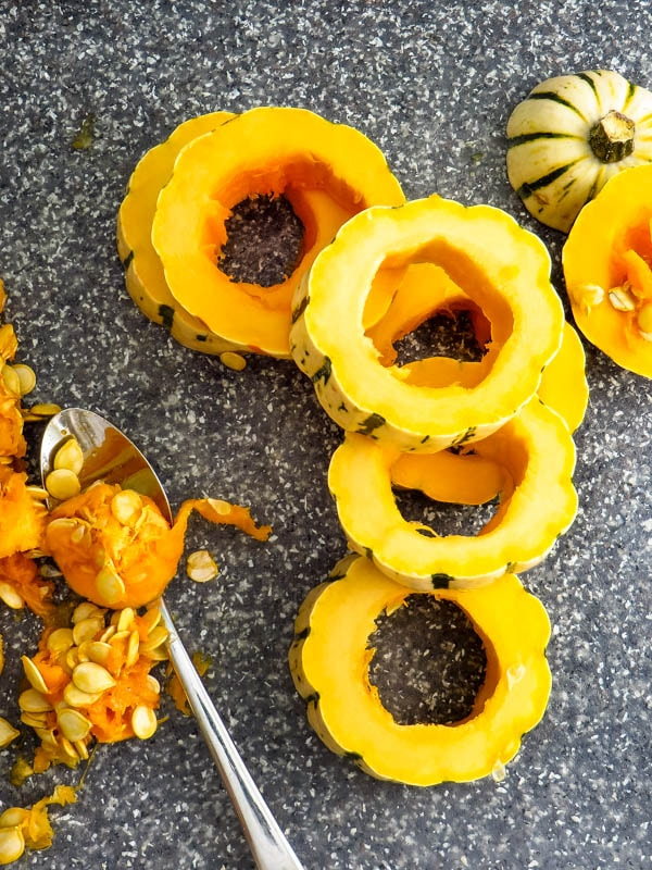remove the seeds from the acorn squash.