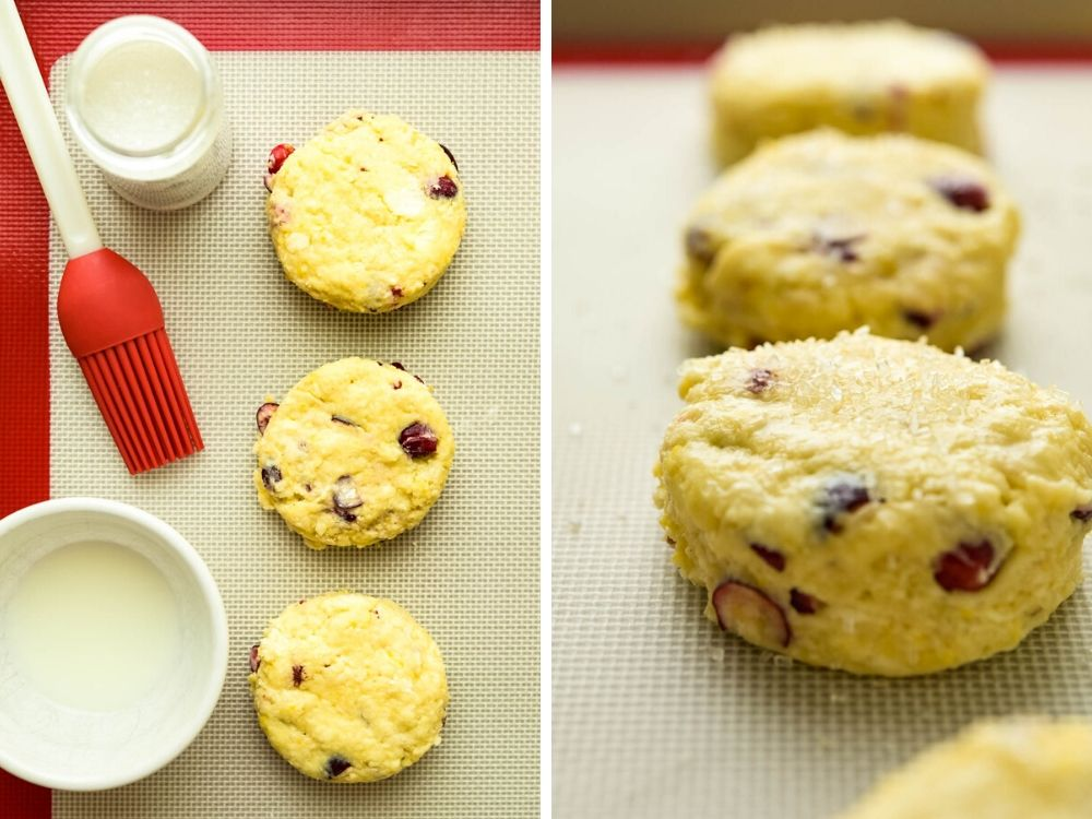 brushing homemade scones with milk and sprinkling with sugar.