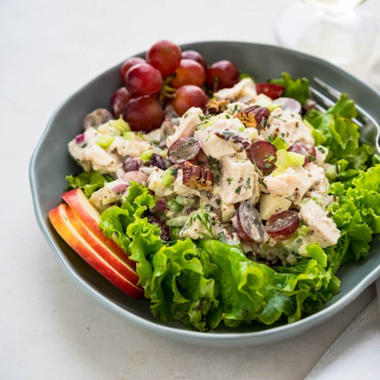 Loaded Chicken Waldorf Salad on a bed of greens.