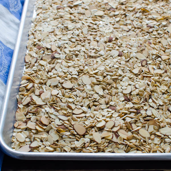 toasting almonds, oats, sunflower seeds and wheat germ