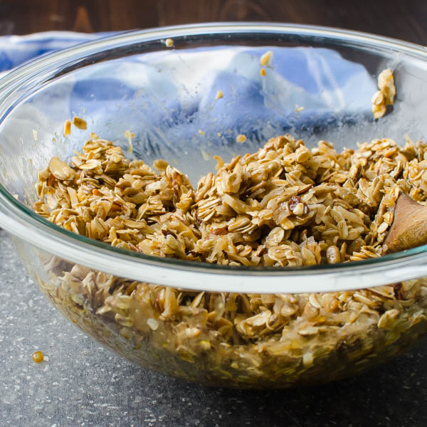 mixing granola in a bowl