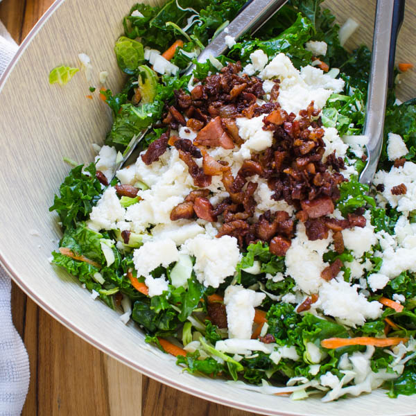 adding feta and pancetta to salad.