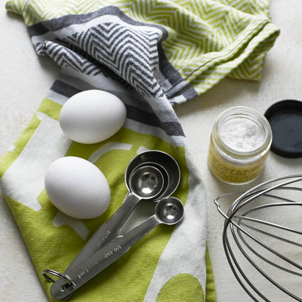 eggs, cream of tartar and measuring spoons with whisk attachment for simple meringue recipe.