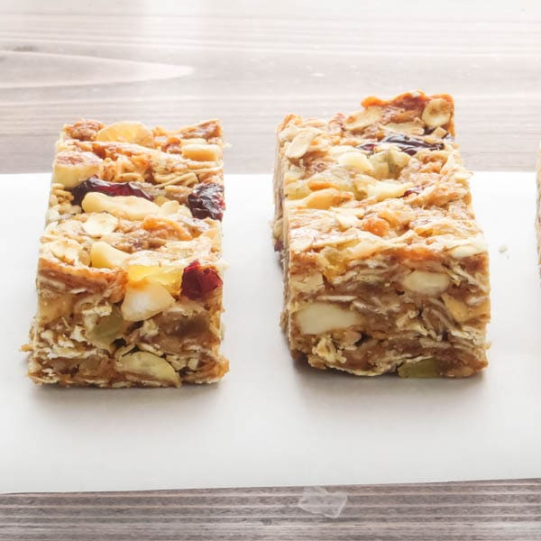 Pineapple Macadamia Granola Bars on parchment.
