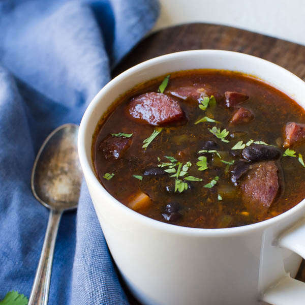 a cup of Black Bean and Sausage Soup
