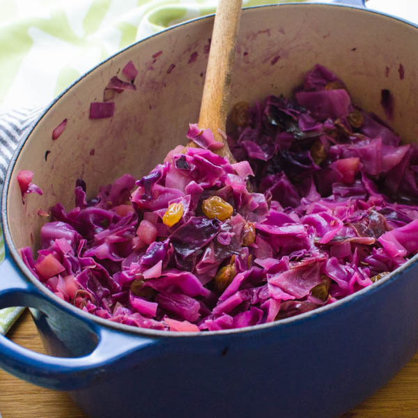 Sweet and Sour Red Cabbage with Apples and Raisins in a dutch oven.