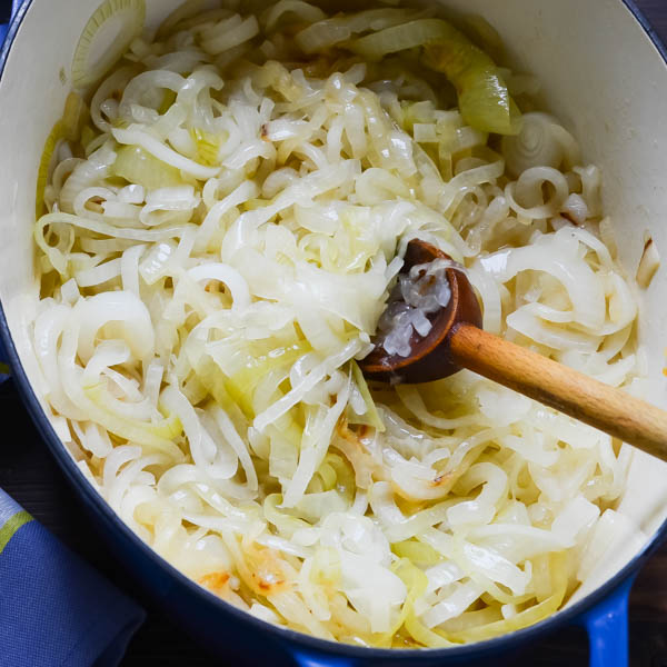 Cooking the yellow onions.