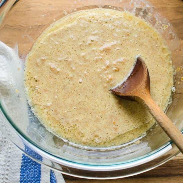 mixing wet ingredients to break down cereal.