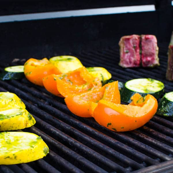 grilling peppers, zucchini, squash and lamb.